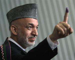 Afghanistan Votes for President, Karzai Casts his Vote