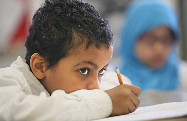 Yahya Mohamed listens intently to his teacher in his grade three class at the Muslim Association of Canada