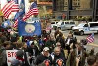 Anti-war US veterans march along with protesters for Occupy Wall Street at Zuccotti Park in New York.