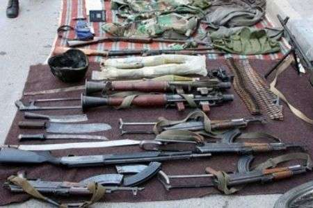 The Syrian Army displays weapons seized from armed gangs in the town of Jisr al-Shughour, north of the capital Damascus, on June 13, 2011.