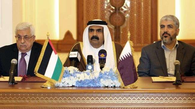 Qatari Emir Sheikh Hamad Bin Khalifa Al Thani (C), acting Palestinian Authority Chief Mahmoud Abbas (L) and Hamas Political Bureau chief Khaled Meshaal attend a meeting in Doha, February 6, 2012.
