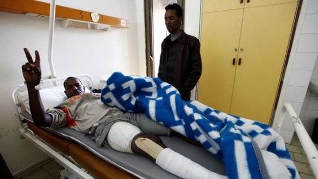 A Libyan injured during the fights between rival tribes rests after receiving treatment at the Tripoli Medical Centre, February 24, 2012.