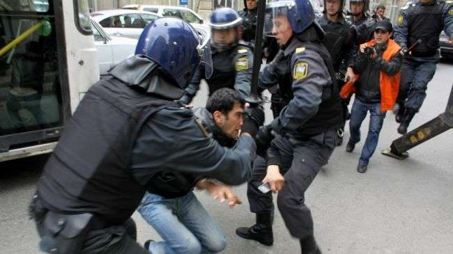 Azeri police forces arrest a protester during anti-government demonstrations in Baku, April 2011.