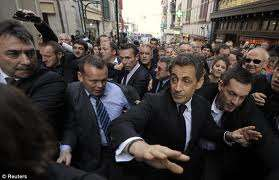 Sarkozy forced to hide from angry protesters