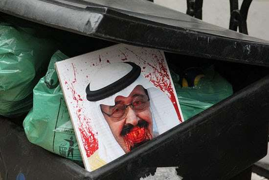 دعوات لإحراق صور ملک السعودیة لإحتلال قواته البحرین