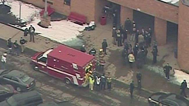 Emergency services gather outside an American high school in the US state of Ohio after a shooting which killed five people in February, 2012.