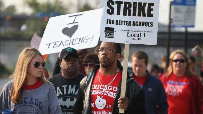 Striking Chicago public school teachers picket outside of George Westinghouse College Prep high school on September 17, 2012 in Chicago, Illinois.