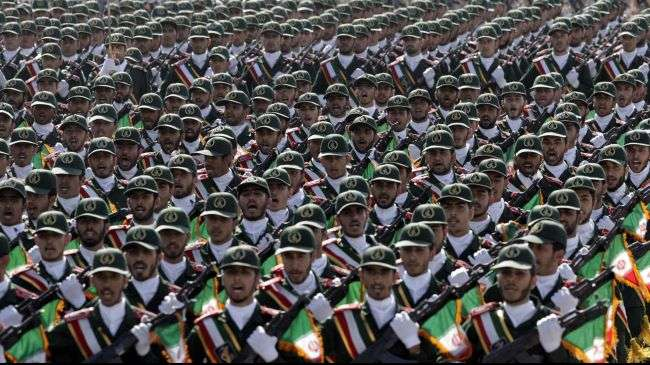 IRGC troops march during a military parade near Tehran.