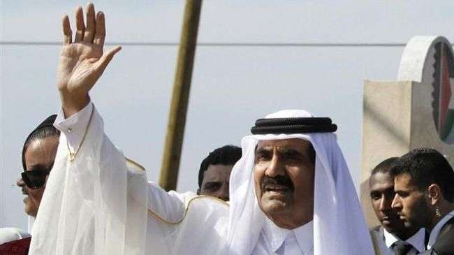 Emir of Qatar Sheikh Hamad bin Khalifa Al Thani waves to the crowd as he arrives in the Gaza Strip on October 23, 2012.