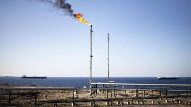 Oil tankers are seen waiting to refill in the water off the Zawiya Refinery, some 40 kilometers west of Tripoli, on October 27, 2011.