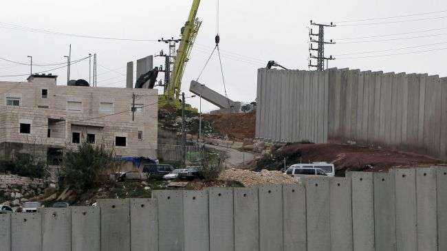 A crane completes a section of Israel
