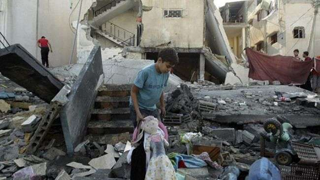 A Palestinian is seen at the site of an Israeli airstrike in the city of Rafah in southern Gaza, November 20, 2012.