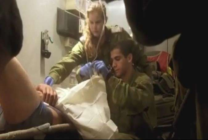 The photo shows Israeli soldiers giving medical assistance to wounded Syrian Takfiri militants.