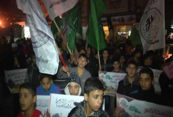 "Palestinians in the Gaza Strip rally against an Egyptian court ruling that labels Hamas a ""terrorist"" group, February 28, 2015."
