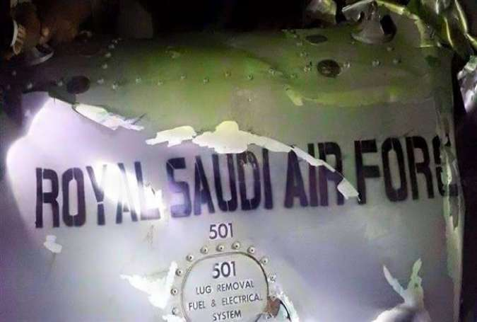 "The words ""Royal Saudi Air Force"" are visible on the body of a fighter jet that has crashed in Yemen."