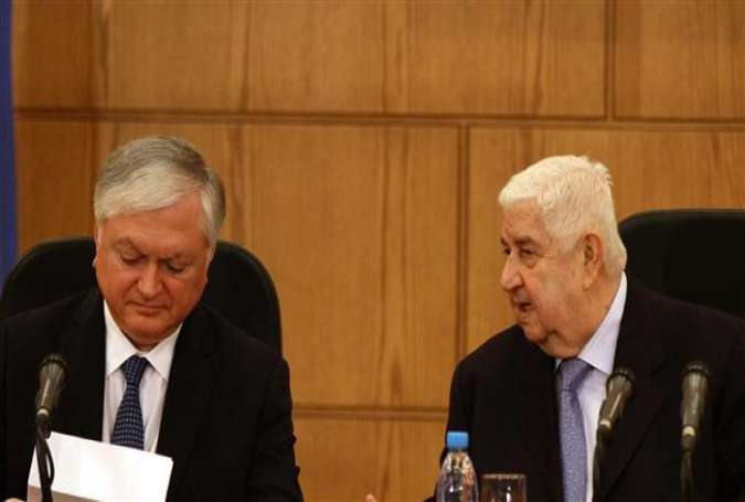 Syria's Foreign Minister Walid al-Moallem (R) alongside Armenian Foreign Minister Edward Nalbandian at a press conference in Damascus on May 27, 2015.