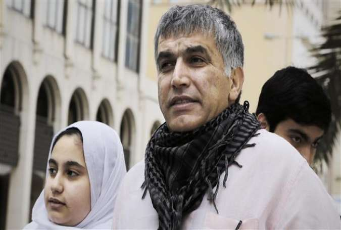 Bahraini human rights activist Nabeel Rajab (C) and his daughter Malak (L) leave a court building after attending his appeal hearing on February 11, 2015 in the capital Manama.