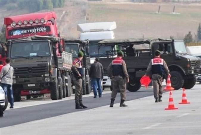 Trucks allegedly belonging to the Turkish intelligence service (MIT) being halted while en route to Syria carrying weapons for foreign-backed militants.