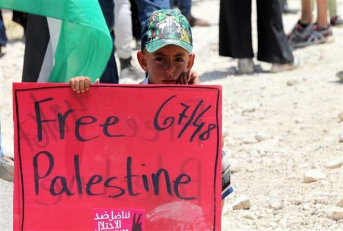 A child holds a banner during a protest against the planned demolition of the Susya village in the occupied West Bank on June 5, 2015.