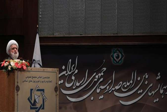 Hezbollah's Deputy Secretary General Sheikh Naim Qassem addresses the 8th Assembly of Islamic Radios and TVs Union in the Iranian capital of Tehran on August 16, 2015.