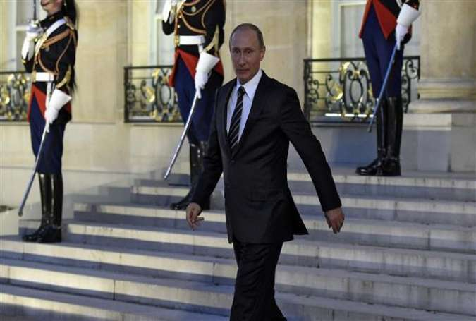 Russian President Vladimir Putin leaves the Elysee Palace in Paris at the end of a summit on the Ukraine crisis with leaders of France, Germany and Ukraine, October 2, 2015.
