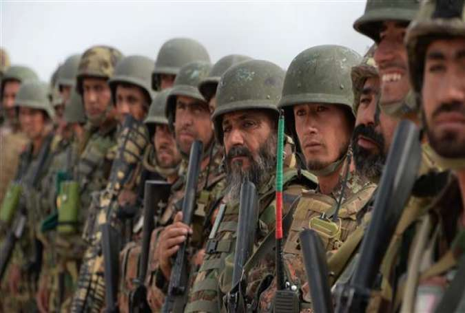Afghan security personnel gather to leave the Khogyani district after a month-long anti-Taliban operation in various parts of Afghanistan's eastern province of Nangarhar on August 30, 2015.