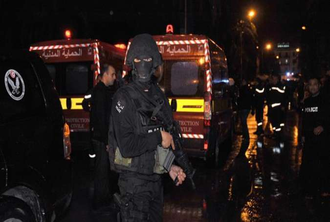 Tunisian police block the road leading to the site of an explosion on a bus transporting Tunisia