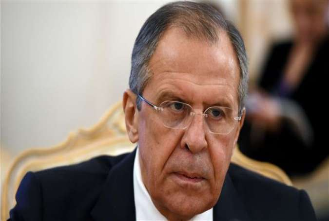 Russian Foreign Minister Sergey Lavrov looks on during a meeting with his Syrian counterpart Walid al-Muallem (unseen) in Moscow on November 27, 2015.