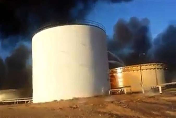An image grab taken from a video uploaded on social networks on January 5, 2016 shows a petroleum storage tank burning at the Sidra oil terminal in Libya.