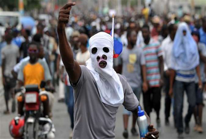 Demonstrators march during a protest in Port-au-Prince, on January 22, 2016.
