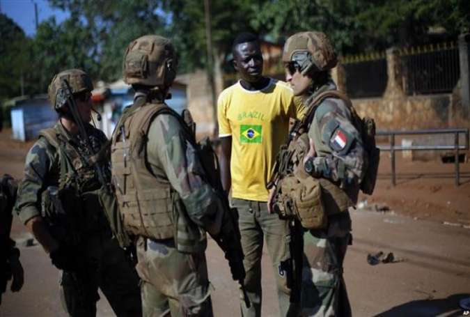 French troops speaking to a local resident outside Fatima Church in Bangui, the Central African Republic.