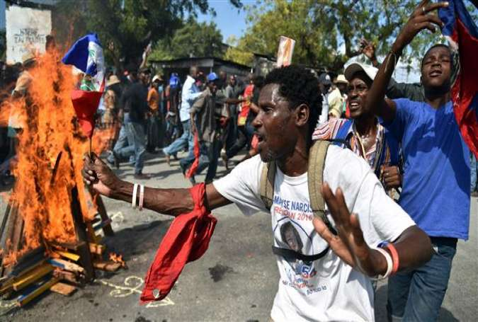 Pro-opposition Haitians protest the planned deployment of an election mission by the Organization of American States (OAS) in Port-au-Prince on January 29, 2016.