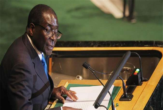 Zimbabwe President and outgoing African Union chairman, Robert Mugabe, addresses the opening ceremony of the 26th Ordinary Session of the AU Assembly in Addis Ababa, Ethiopia, January 30, 2016.