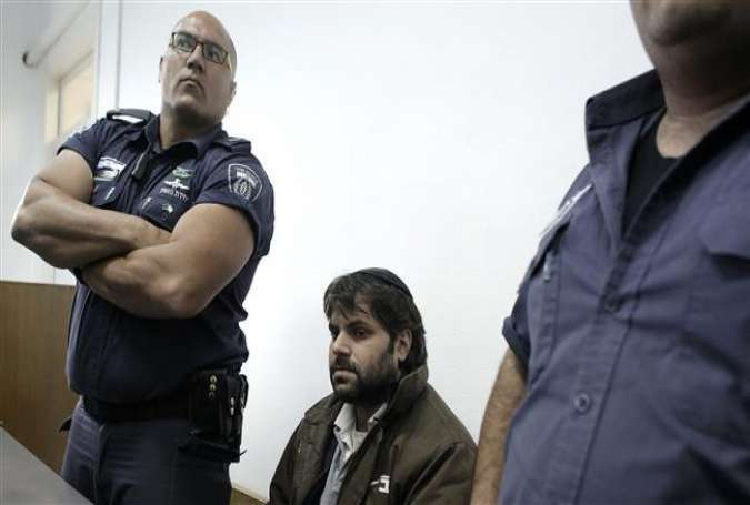 Yosef Haim Ben-David (C), the prime suspect in the abduction and murder of Palestinian teenager Mohammed Abu Khdeir, sits in a courtroom, Dec. 20, 2015.