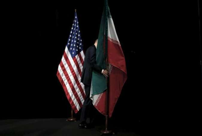 A staff member removes the Iranian flag from the stage after a meeting of officials from Iran and the P5+1 in Vienna.