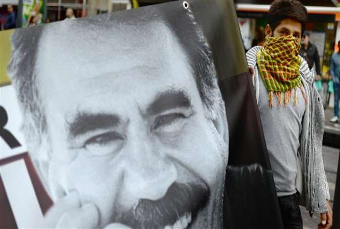 A protestor holds a banner with the photo of the founding member of the Kurdistan Workers' Party (PKK) Abdullah Ocalan in Marseille, in southern France, October 17, 2015.