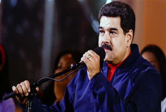 Venezuelan President Nicolas Maduro delivers a speech during celebrations for the 17 years of the Bolivarian Revolution in front of the Miraflores presidential palace, in Caracas on February 2, 2016.