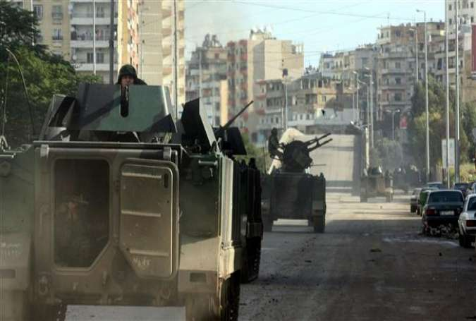 Lebanese soldiers on board armored vehicle