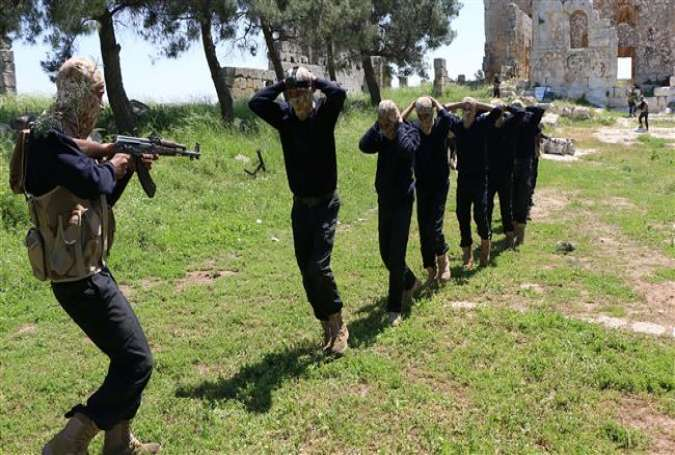 Terrorists take part in military training in the city of Aleppo in northwestern Syria on May 4, 2015.