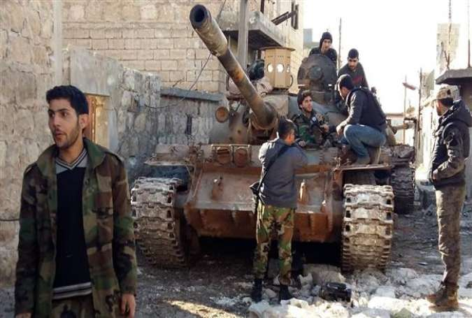 Syrian Government forces positioned near a tank located some three kilometers from the villages of Nabbul and Zahra in Syria