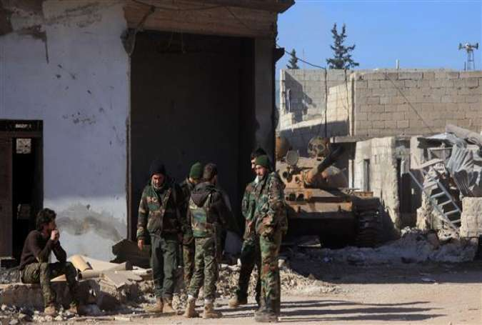 Syrian government forces stand in the village of Tal Jabin, north of the city of Aleppo, on February 3, 2016.