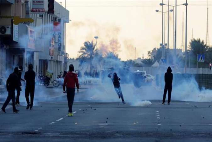 Bahraini police forces fire tear gas at anti-government protesters on the island of Sitra, January 29, 2016.