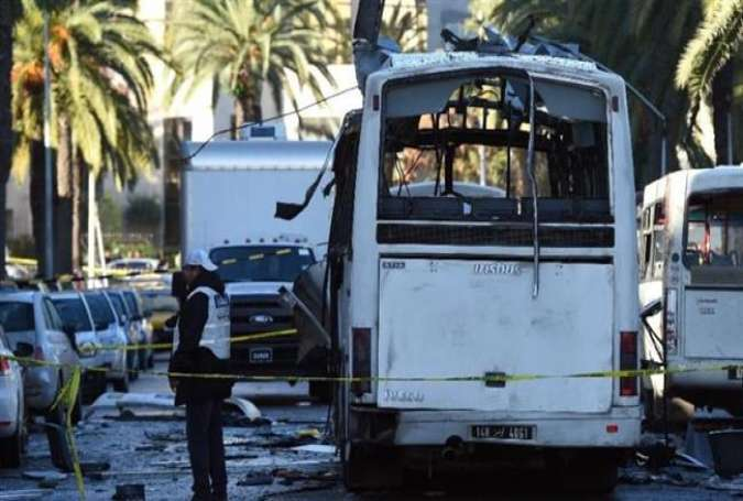 Tunisian forensic police inspect the wreckage of a bus in the capital, Tunis, on November 25, 2015 in the aftermath of a bomb attack on the vehicle the previous day.