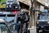 Jordanian security forces secure Hakama street during a raid in downtown Irbid, north of Amman.