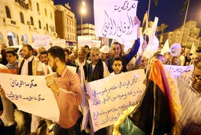 Pro-UN-backed government protesters hold placards and shout slogans during a demonstration in the Libyan capital Tripoli on April 1, 2016.