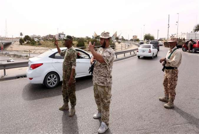 Libyan security forces instruct drivers on a road in the capital, Tripoli, March 31, 2016.