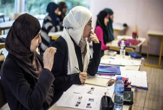 French girls, wearing headscarves, are studying in a Muslim school.