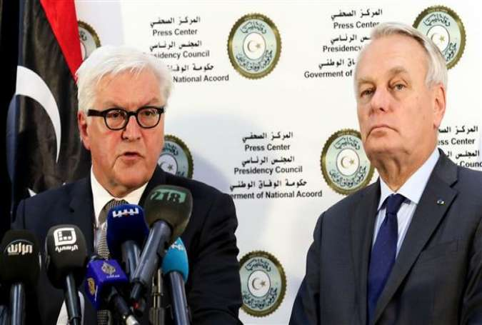 German Foreign Minister Frank-Walter Steinmeier (L) and his French counterpart Jean-Marc Ayrault give a press conference at a naval base in Tripoli on April 16, 2016.