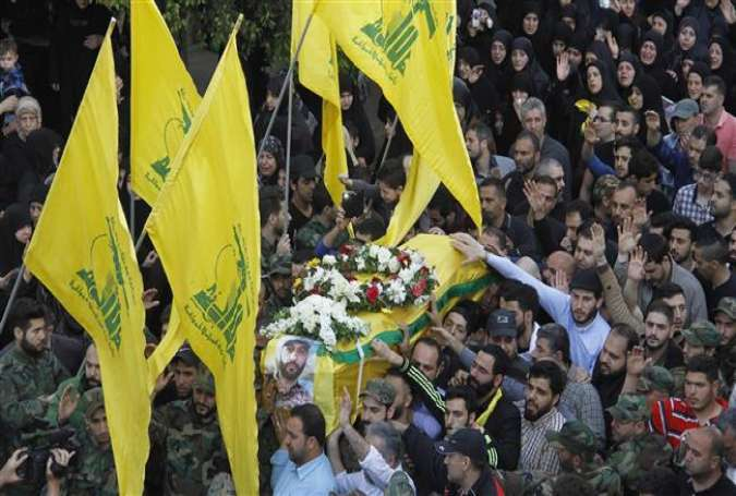 The relatives and members of Lebanon's resistance movement Hezbollah carry the coffin of Lebanese fighter Ali Taha, who was killed in combat alongside Syrian government forces in Syria, during his funeral procession in a southern suburb of the capital, Beirut, April 4, 2016.