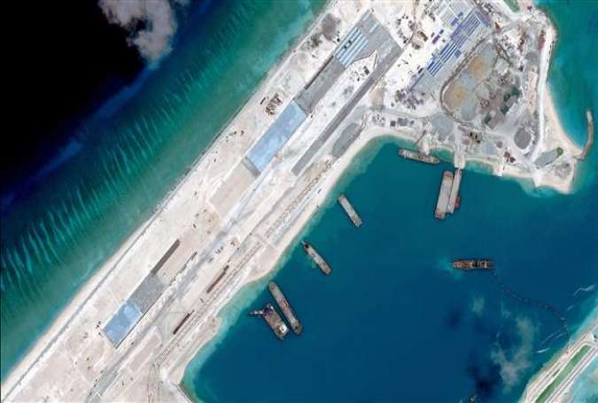 A satellite image of an under-construction runway at Fiery Cross Reef in the South China Sea, April 2, 2015.